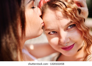 two lesbian girls gently hug and kiss. LGBT concept, minority sex, love, equality