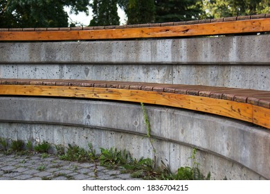 Two levels curved grey and brown bench