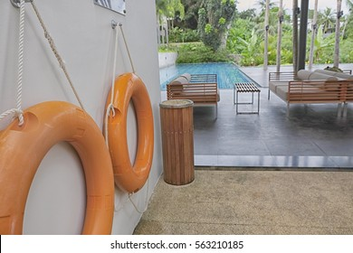 Two Life ring on wall in clubhouse, swimming pool, with select focus