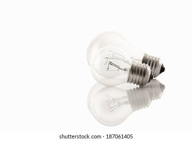 two light bulbs isolated on white with reflects