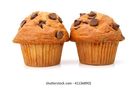 Two light chocolate chip muffins in wax liner on white.