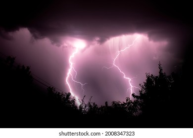 two lightening strikes during a storm, long exposure photo  - Shutterstock ID 2008347323
