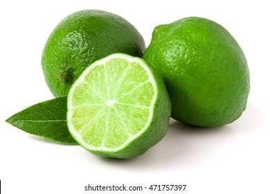two limes with half and leaf isolated on white background