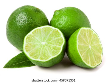 two limes with halves and leaf isolated on white background