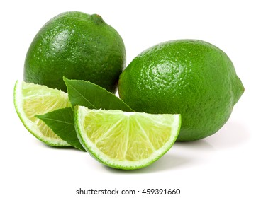 two limes with slices and leaf isolated on white background