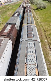 Two lines of grain cars on railway tracks