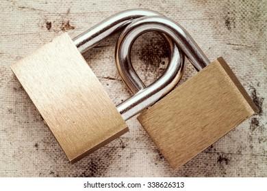 Two linked padlocks symbolizing good relationships or marriage