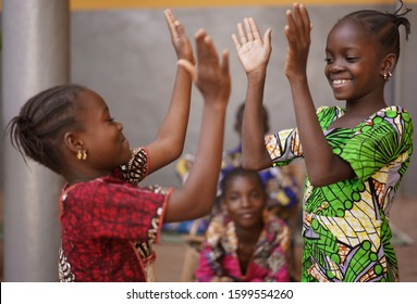 Two Little African Girls Performing A Hand Clapping Game