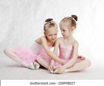 Two Little Ballet Girls Sitting in tutu