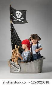 Two little boys imagine themselves as pirates searching for treasure on the ship
