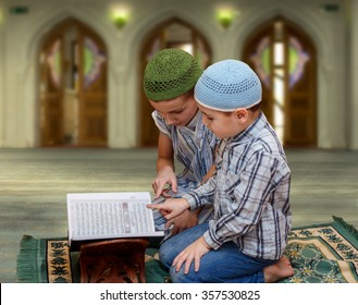 two little  boys in the mosque read the Quran