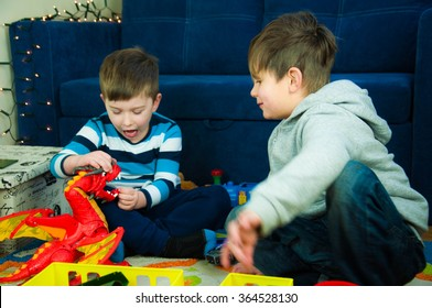 Two little boys playing at room