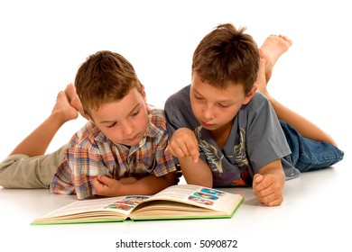 two little boys reading-against white