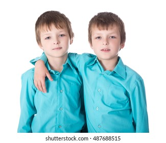 two little boys twins isolated on white background