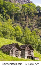 Two little cabins, named Rustico, typical for the region Ticino, Tessin, Swiss Alps.