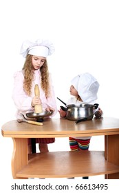 two little cooks in studio isolated on white
