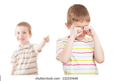 Two little displeased child boy brothers in family conflict quarrel