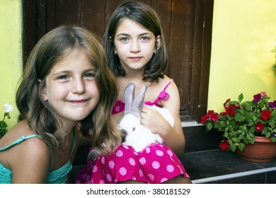 Two little girl with a bunny rabbit  outdoor