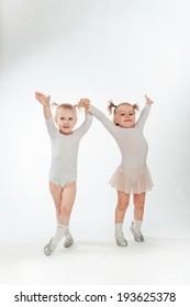 Two little girl doing gymnastics