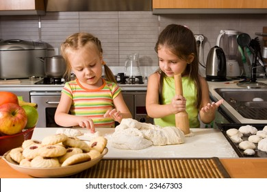 Two little girl learning how to cook