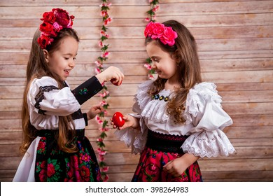Two little girl in popular Romanian costume enjoying the Easter holidays