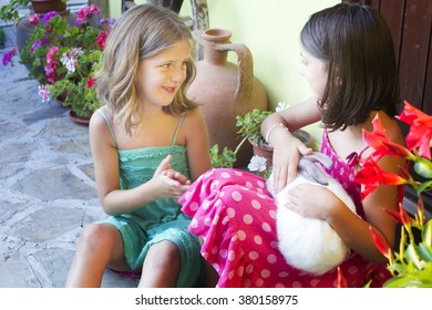 Two little girl with a rabbit.Two little girl with a bunny rabbi