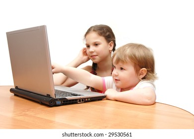 Two little girls behind the laptop