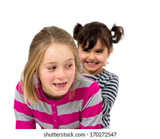 two little girls combing isolated on white
