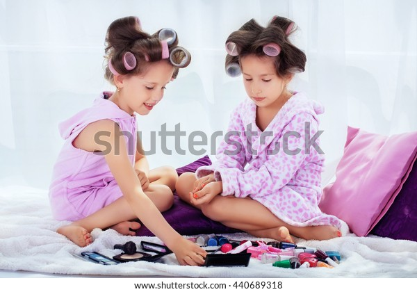 Two little girls in a curler make-up