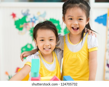 Two little girls embracing in the studio