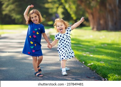 Two Little Girls Having Fun in the Park