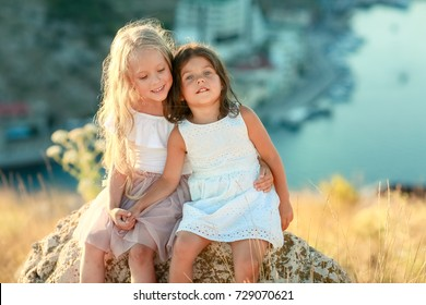Two little girls,  high in the mountains for a walk on vacation