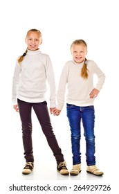 two little girls isolated on a white background