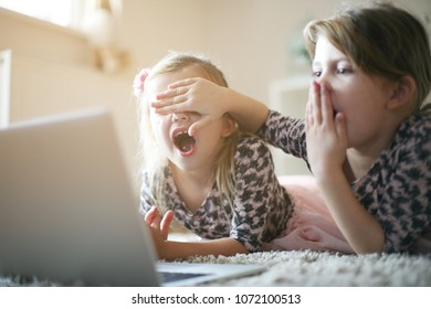 Two little girls with laptop. Close up.