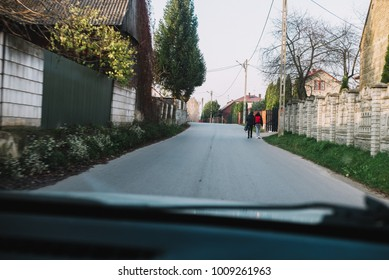 two little girls on the street, returning from the school