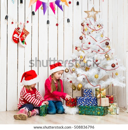 Christmas Presents For Girls.Two Little Girls Open Christmas Presents Stock Photo Edit
