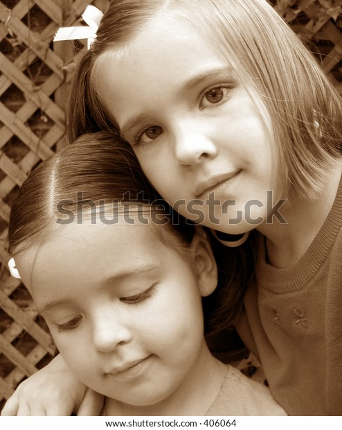 Two little girls.  Sepia tone.