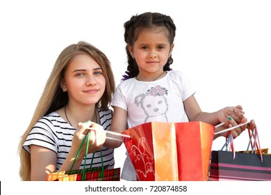 Two little girls with shopping bags. Isolated over white background - Shutterstock ID 720874858
