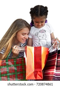 Two little girls with shopping bags. Isolated over white background - Shutterstock ID 720874861