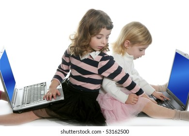 two little girls sister studying computer laptops at school