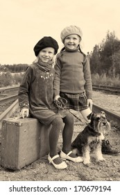 two little girls traveling with miniature schnauzer