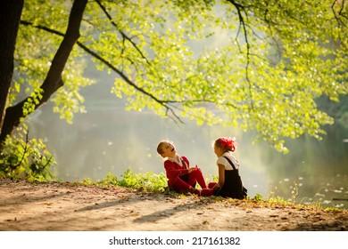 Two little girls walking in park after school