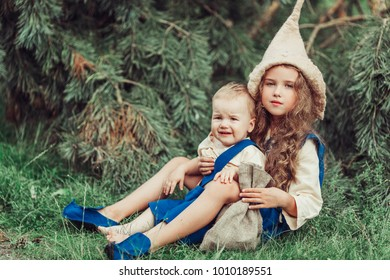Two little gnomes have a nice time in a green forest