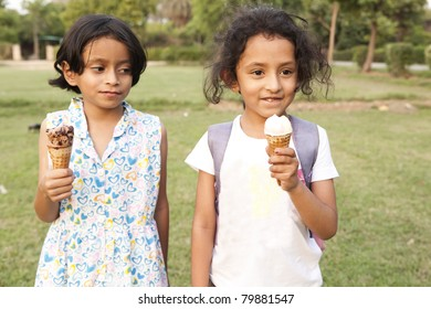 two little Indian girls eating ice cream