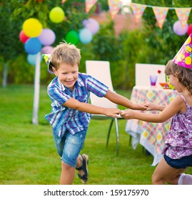 Two little kids celebrating birthday dancing roundelay