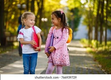 Two little kids going to school together