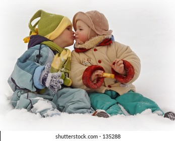 two little kids kissing in the snow