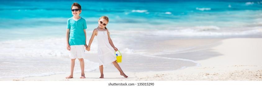Two little kids at a tropical beach