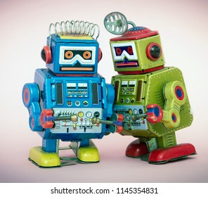 two little robots share some gossip  macro image