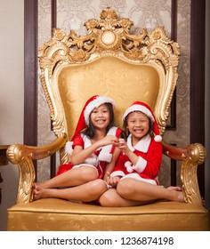 Two little santa girls in Santa Claus concept